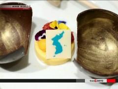 朝韩首脑晚餐甜点图案包含独岛 日政府:无法接受